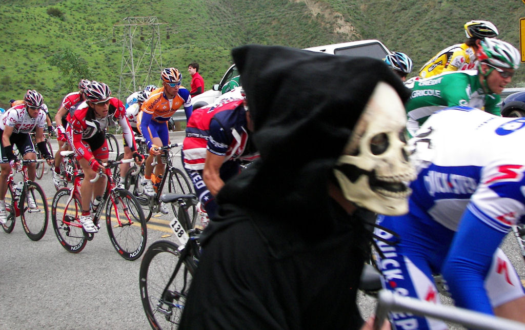 Grim Reaper running with the peloton